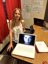 Eighth-grader Emily Rutherford shows off the documentary on the camera she created with fellow student Rowan Esquer.